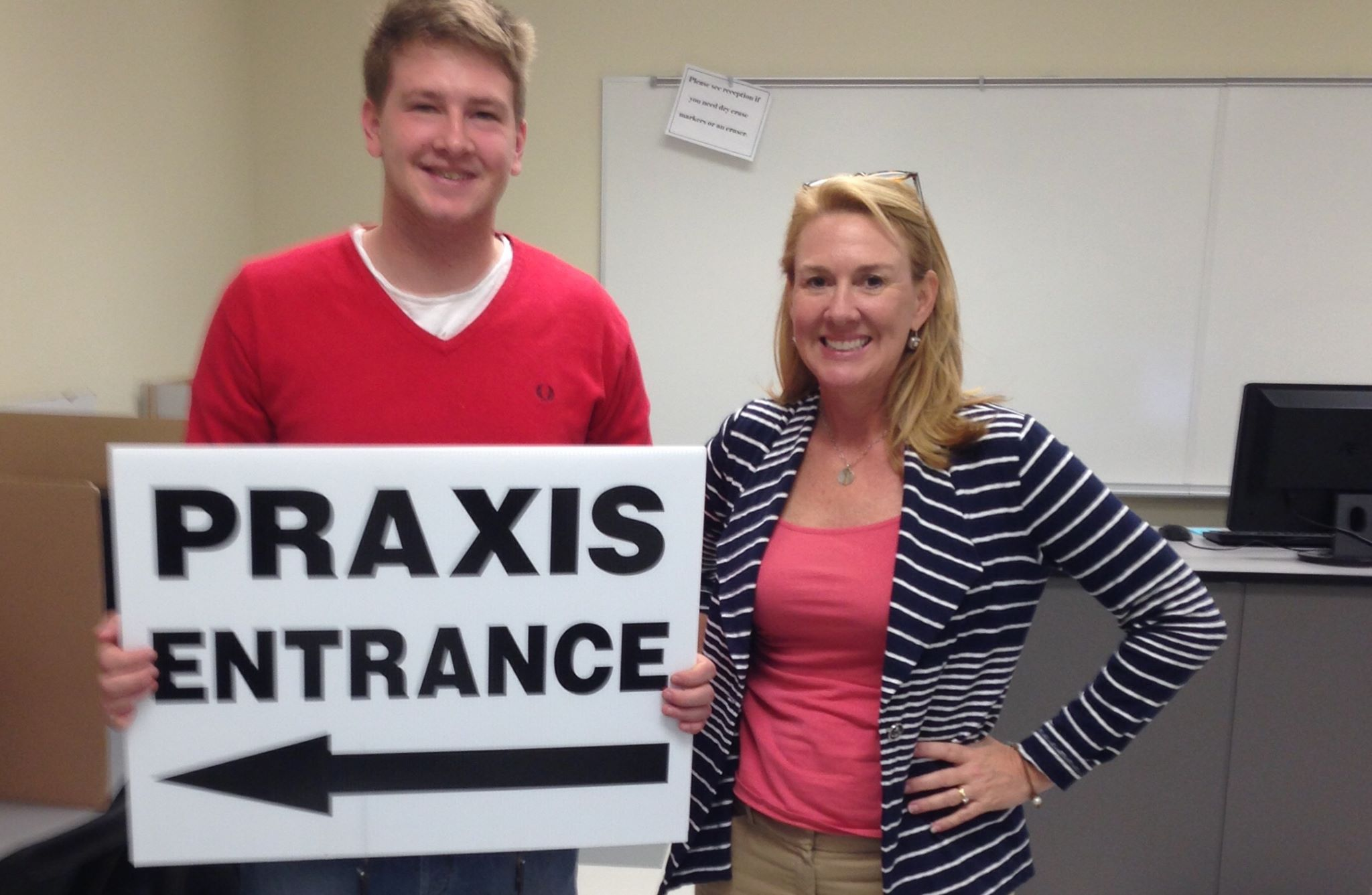 Kenda and Student with Praxis sign